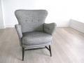 A black and white 1950s armchair