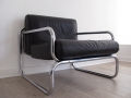 A leather & chrome lounge chair. OMK Rodney Kinsman