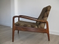 A solid teak armchair by Greaves & Thomas
