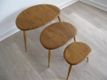 A solid elm nest of pebble tables. Lucian Ercolani for Ercol