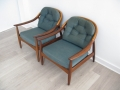A pair of teak lounge chairs. Greaves & Thomas