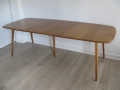 A solid elm ercol extending dining table