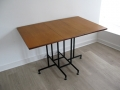 A Ladderax teak/metal drop-leaf table