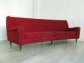 A Danish curved 4 seater sofa