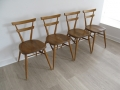 4 Ercol 'green dot' adult stacking chairs