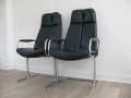 A pair of leather 'eleganza' carver chairs by Pieff
