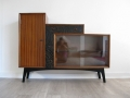 An unusual 1950s cabinet with carved drawers