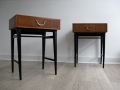 A pair of 1970s bedside tables with ebonised legs