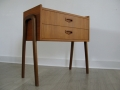 A 1950s compact teak chest of drawers/bedside cabinet