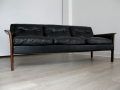 A Danish black leather and solid rosewood 3-seater sofa
