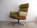 A Guy Rogers leather swivel lounge chair