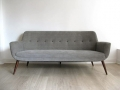 1950s sofa with solid teak legs. Fully reupholstered