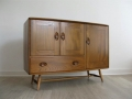 A 1950s solid elm sideboard by Lucian Ercolani for Ercol