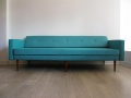 A large 1960s daybed. Solid teak legs. Reupholstered