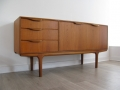 A compact teak sideboard by A.H. McIntosh and Co