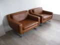 A pair of tan leather 'aspen' chairs by Terence Conran