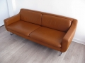 A tan leather 'Aspen' sofa by Terence Conran