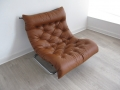 A 1970s tan leather and tubular chrome lounge chair