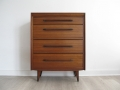 A 1950s teak chest of drawers