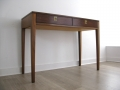 A 1970s rosewood desk by Archie Shine for Heals