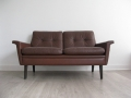 A compact 2 seater leather Danish sofa