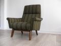 A Danish lounge chair on solid teak legs