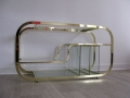 An Italian brass chrome and glass console table