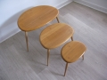 A set of pebble tables by Ercol