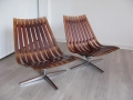 Pair of rosewood swivel Scandia lounge chairs by Han Brattrud